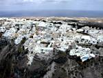 Aerial photo of Santorini - Fira / Skala town perched on the cliffs of the caldera
